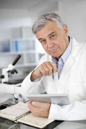 Portrait of scientist in lab using digital tablet Stock Photo - 16320679