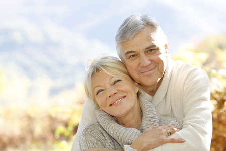 Senior couple embracing each other in countryside photo