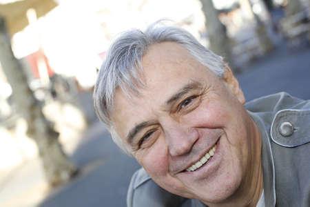 Portrait of smiling senior man standing outside Stock Photo - 16320809