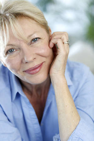 serenity: Closeup of senior woman with blue shirt Stock Photo