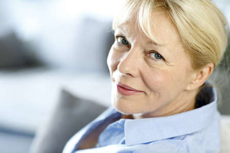 60 years old: Closeup of senior woman with blue shirt Stock Photo