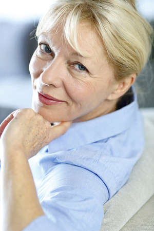 60 years: Closeup of senior woman with blue shirt Stock Photo