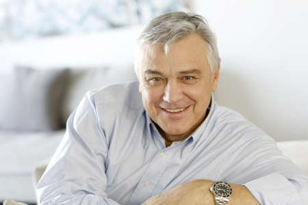 senior man: Portrait of senior man relaxing in sofa at home