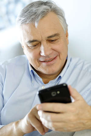 Portrait of senior man using smartphone Stock Photo - 16397515