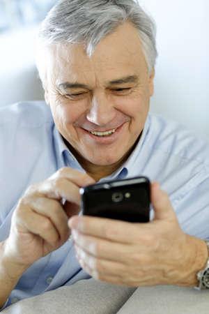 grandfather: Retrato de hombre mayor utilizando tel�fono inteligente Foto de archivo