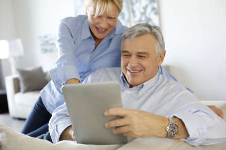 Modern senior couple websurfing on tablet Stock Photo - 16397328