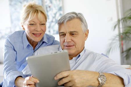 websurfing: Modern senior couple websurfing on tablet Stock Photo
