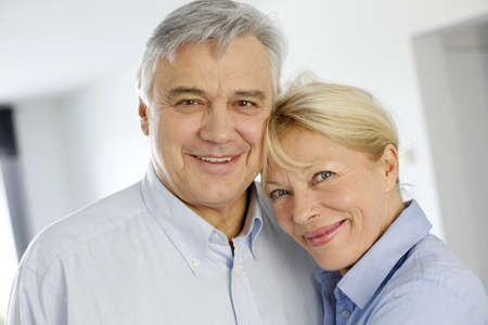 Portrait of cheerful senior couple at home photo