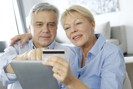 Senior couple doing shopping on internet Stock Photo - 16397513