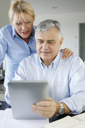 Senior couple looking at bank account on digital tablet Stock Photo - 16398186