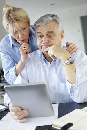 Senior couple trying to figure out tax declaration photo
