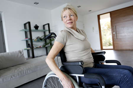 Portrait of senior woman in wheelchair photo