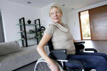 injured woman: Portrait of senior woman in wheelchair