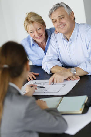 real estate planning: Senior couple meeting architect for building project Stock Photo