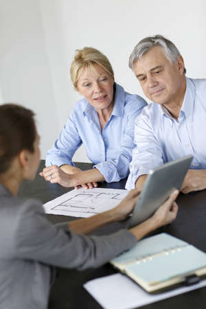 architect office: Senior couple meeting architect for building project Stock Photo