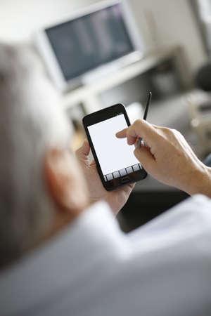 Back view of senior man using smartphone Stock Photo - 16397232