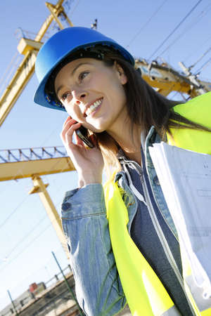 lifejacket: Construction manager talking on mobile phone