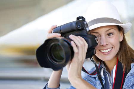 capturing: Photographer capturing photo with professional camera Stock Photo