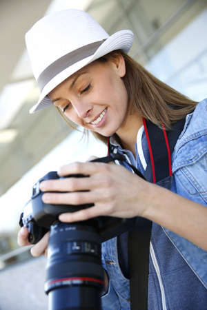 Young reporter looking at photo captures Stock Photo - 16398428