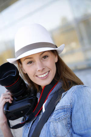 Beautiful woman photographer holding photo camera photo