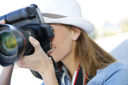 apprenticeship: Woman photographer taking professional pictures Stock Photo