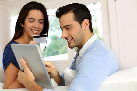 Young couple shopping online from home photo