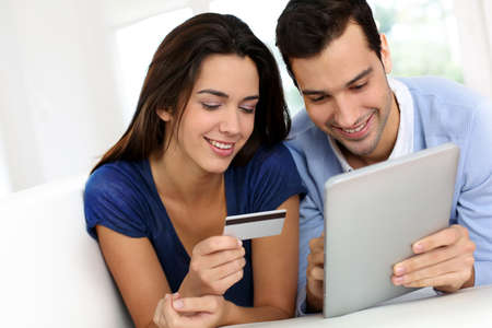 buying online: Young couple shopping online from home