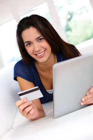 thirties portrait: Brunette girl doing online shopping with digital tablet Stock Photo