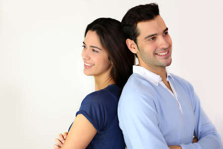 Young in love couple standing back to back  photo