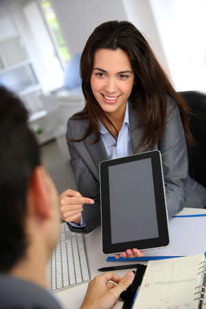 pda: Businesswoman doing presentation on electronic tablet