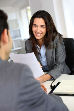 candidates: Businesswoman giving job interview Stock Photo