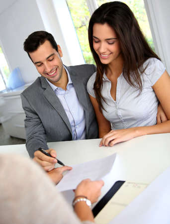 future sign: Young couple signing financial contract