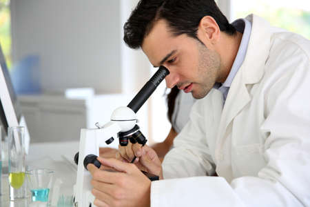 Doctor in biology working on microscope photo