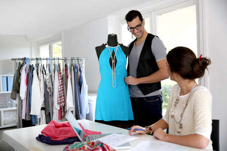 Fashion designers working on creation in workshop photo