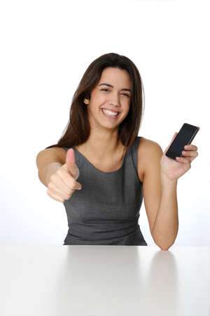 Young woman with smartphone showing thumb up photo