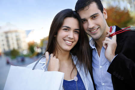 Smiling couple doing Christmas shopping photo