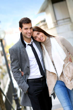 couple WALKING: Trendy couple of lovers walking in the street Stock Photo