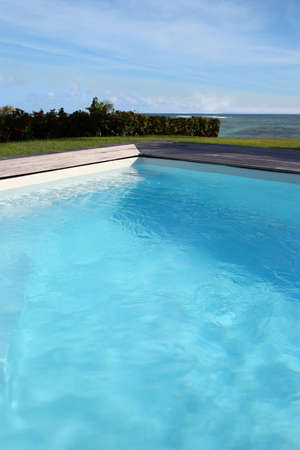 Closeup of private swimming-pool by the sea photo