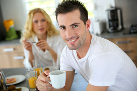 Portrait of young man holding cup of coffee Stock Photo - 16949335
