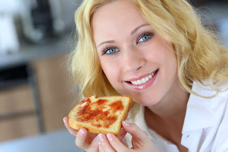 Beautiful girl eating toasted bread for breakfast Stock Photo - 16949313