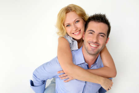 blonde couple: Man carrying girlfriend on his back Stock Photo