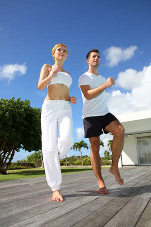 aerobic treatment: Woman with coach exercising outside