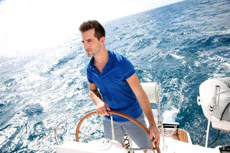 skipper: Young man sailing in caribbean sea  Stock Photo