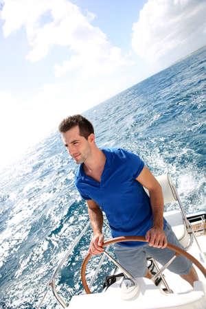 Young man sailing in caribbean sea  photo