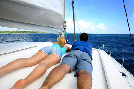 recreational vehicle: Couple relaxing on a sailing boat while cruising