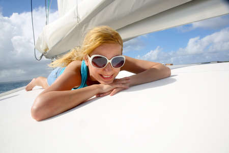 Young woman with sunglasses relaxing on yacht photo
