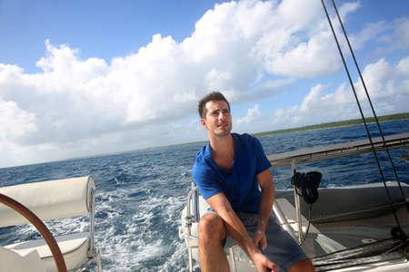 Sailot pulling on sail rope during navigation Stock Photo - 16969975