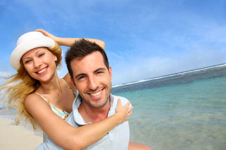 Cheerful couple enjoying vacation at the beach photo