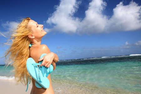 suntanning: Beautiful girl suntanning by the beach Stock Photo
