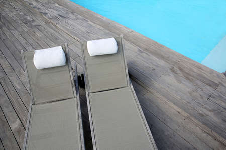 pool deck: Closeup of long chairs set by resport pool
